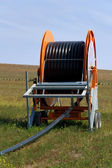 Spool of Irrigation Pipe — Stock Photo