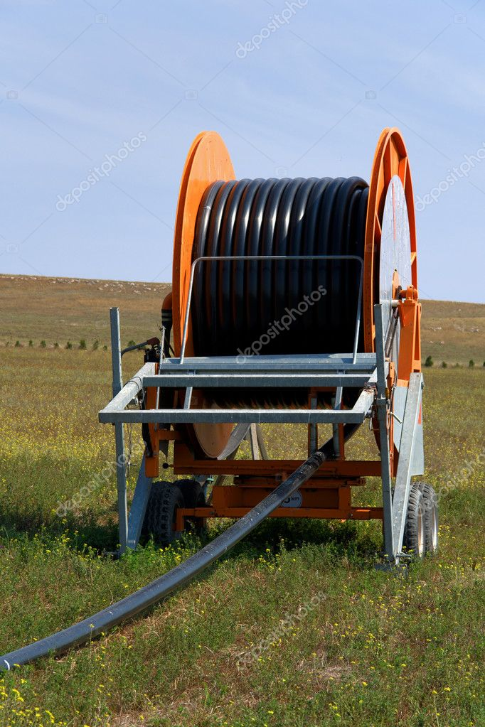Spool of Irrigation Pipe — Stock Photo #6950642