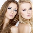 Stock Photo: Two girl friends - blond and brunette