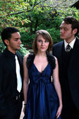 Beautiful Girl Looked upon by Two Guys — Stock Photo