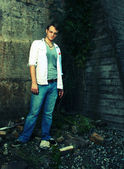 Cross Process photo of man by old wall — Stock Photo