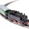 Toy steam train pulling one carriage — Stock Photo