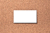 White business card on corkboard — Stock Photo