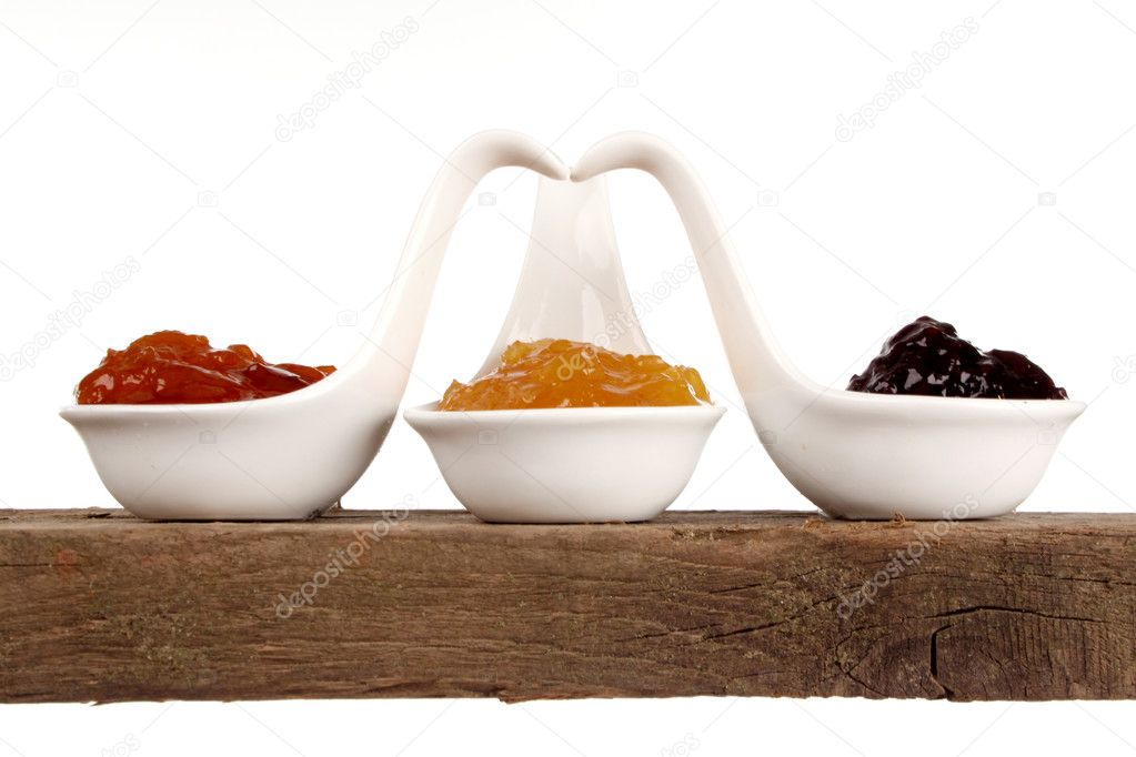 Various kinds of marmelade on a shelf in a studio setting — Stock Photo #7129407