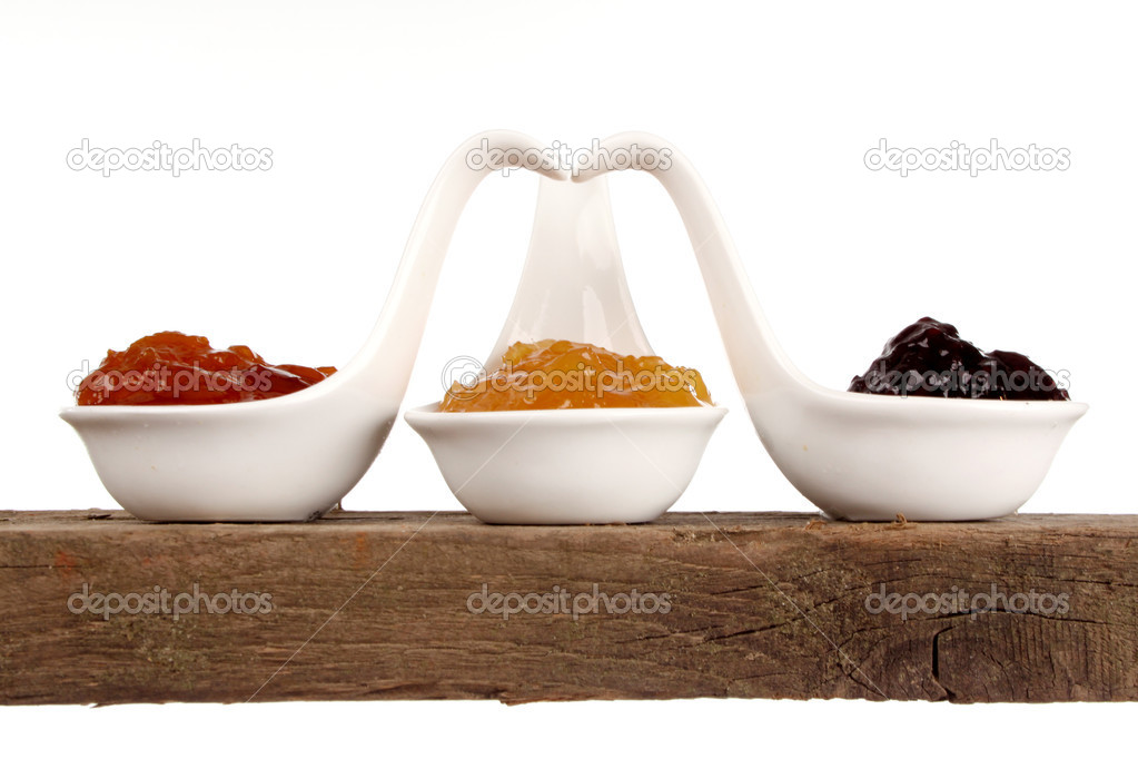 Various kinds of marmelade on a shelf in a studio setting — Stock Photo #7152803