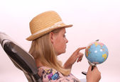 Young female in a studio setting planning a holiday — Stock Photo