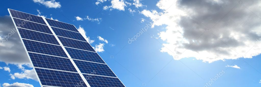 Panorama of solar panels over blue sky — Stock Photo #7254628