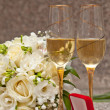 Foto de Stock  : Wedding bouquet, rings and champagne