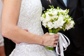 The bride has control over a bouquet — Stock Photo
