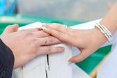 Hand of the bride on a hand of the groom — Stock Photo