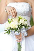 Bouquet in hands of the bride — Stock Photo