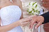 The bride dresses a ring to the groom — Stock Photo