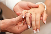 The groom dresses a ring to the bride — Stock Photo