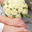Stock Photo: Wedding rings on hand of groom and bride