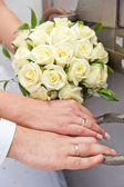 Wedding rings on a hand of the groom and the bride — Stock Photo