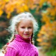 Stock Photo: Schoolage girl autumn outdoor portrait
