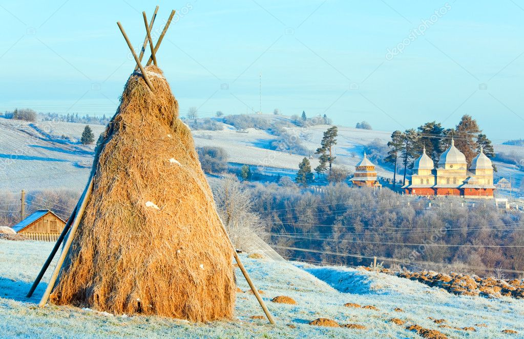 Autumn morning hoarfrost on mountain village outskirts pasture and haystack — Stock Photo #6865050
