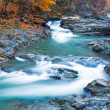 Waterfalls on Rocky Autumn Stream - Stock Photo
