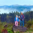Family on september Carpathian mountain hill — Stock Photo