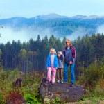 Family on september Carpathian mountain hill — Stock Photo