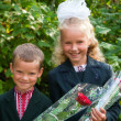 Portrait of nice little schoolgirl and schoolboy — Stock Photo #7015258