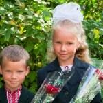 Portrait of nice little schoolgirl and schoolboy — Stock Photo