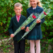 Stock Photo: Portrait of nice little schoolgirl and schoolboy