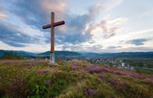 Summer evening country view with wooden cross — Photo