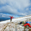 Family on autumn mountain plateau first winter snow — Stock fotografie
