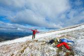Family on autumn mountain plateau first winter snow — Stock Photo