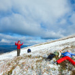Family on autumn  mountain plateau  with first winter snow — Stock Photo