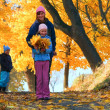 Family in autumn maple park — Stock Photo #7463765