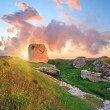 Majestic sunset and ancient fortress ruin - Stock Photo