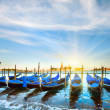 Venice gondolas at sunset — Stock Photo