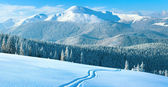Winter mountain panorama with ski track — Stock Photo