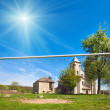 Stock Photo: Old church and football goal (Sydoriv village, Ternopil region,