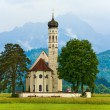 Stock Photo: Neuschwanstein Castle in Germany and church near