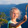 Girl and butterfly in sunset mountain — Stock Photo