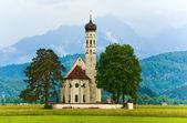 Neuschwanstein Castle in Germany and church near — Stock Photo