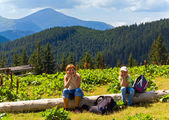 Family in summer mountain — Stock Photo