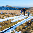 Family walk on autumn mountain plateau with first winter snow — 图库照片