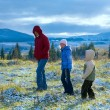 First winter snow in autumn mountain and family on walk — Stock Photo