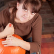 Young girl carving a pumpking — Stock Photo