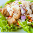 Thai dressed spicy salad with bass, green herbs and nuts : delicious food — Stok fotoğraf