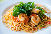 Tasty hot and spicy spaghetti with cream, cheese and parsley close up — Stock Photo
