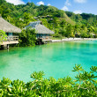 Over water bungalows and a green lagoon - Stock Photo