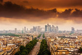Image with dramatic clouds over the Champs Elysees in Paris — Stock Photo