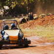 Driving a buggy on the track in the park — Stock Photo