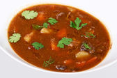 A bowl of beef vegetable soup — Stock Photo
