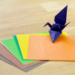 Origami paper and classic crane model (longevity and good fortun — Stock Photo